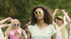 Pretty biracial woman dancing at open-air talent show, showing her skills Stock Footage