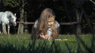 Girl lies and reads the book Stock Footage