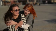 Two girl friends young female friends giving piggyback on vacation laughing and Stock Footage