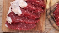 Beef meat steak and chunk on wood Stock Footage