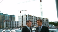 Two architect discuss new building and shows thumbs up Stock Footage