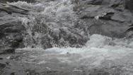 River Flows on Big Rocks Closer Look Nature Footage Stock Footage