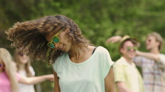 Curly biracial girl relaxing at open-air disco and having fun, summertime Stock Footage