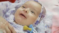 Portrait of a pretty newborn baby in the bath Stock Footage