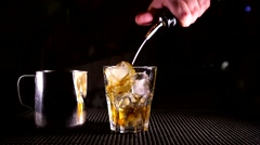 The barman prepares cocktail White Russian Stock Footage