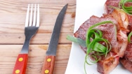 Roasted beef meat on plate over wood Stock Footage