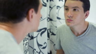 Man with Problem Skin in front of the mirror Stock Footage