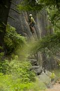 A climber ascends a cliff in Leavenworth, Washington Stock Photos