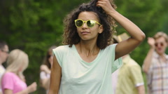 Pretty actress sending air kiss to camera, dancing at open-air party, relaxation Stock Footage