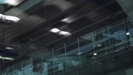 Airport terminal roof reflect people trafic. Still and Glass. People with bags Stock Footage