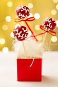 Red and white cake pops Stock Photos
