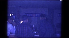 1964: men and women standing around a bar smoking and drinking NIAGRA FALLS Stock Footage