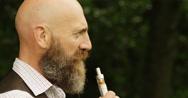 4k, businessman smoking an electronic pipe while on his smoking break. Stock Footage