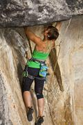 A strong female climber works on Supernatural zombie suspense thriller 11d, Stock Photos