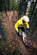 A male mountain biker enjoying perfect fall weather and singletrack in Stock Photos