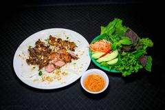 Banh hoi or Vietnamese soft thin vermicelli noodles with herbs and pork Stock Photos