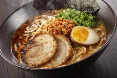 Classic Tantanmen, a rich miso-based broth infused with ground pork and egg Stock Photos