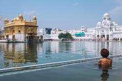 Sikh pilgrim in saint pool in Golden Temple, Amritsar Stock Photos
