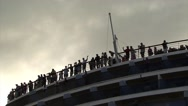 People on the back of a ship waving Stock Footage