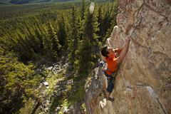 A strong male climber climbing, RUDED2 10d, Silver City, Castle Mtn, Banff, AB Stock Photos