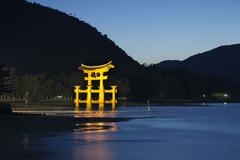 Nightime scene of the giant torii gate that is part of the Itsukushima Shrine Stock Photos