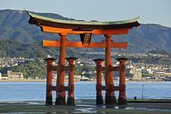 Giant torii gate that is part of the Itsukushima Shrine complex on the island of Stock Photos