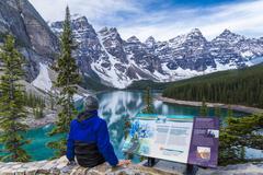 Man at Moraine Lake viewpoint, Banff National Park, Alberta, Canada Stock Photos