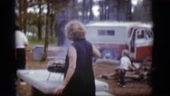 1968: a woman in the park cooking dinner on a portable grill COTTONWOOD, ARIZONA Stock Footage