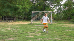Teenager practicing with a soccer ball Stock Footage