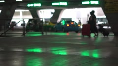 Airport terminal ground reflect bloored lights of LED signs. Taxi cars. People Stock Footage