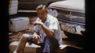 1968: a man drinking in the outdoors COTTONWOOD, ARIZONA Stock Footage