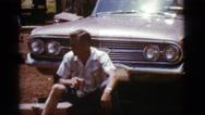 1968: a man is seen sitting near a car COTTONWOOD, ARIZONA Stock Footage