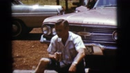 1968: man sitting outside in front of car, drink in hand COTTONWOOD, ARIZONA Stock Footage