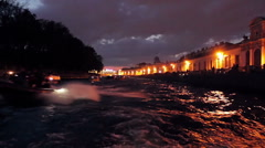 POV from Pleasure Boat Follows by City Canal at Night Stock Footage