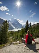 An attractive, young lady takes in the stunning view of Mount Robson, Berg Lake Stock Photos