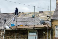 Decorative slate roof restoration in Wales. Stock Photos