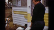 1968: a middle age woman at a camping lot goes into her 1950's camping trailer. Stock Footage