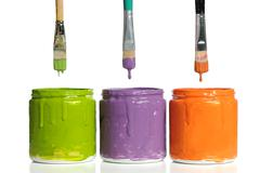 Paintbrushes Dripping Paint into Containers Stock Photos