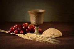 Communion Table With Wine Bread Grapes and Wheat Stock Photos