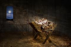 Jesus Resting on a Manger Stock Photos