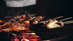 Cooking seafood and vegetables on grill at night Stock Footage