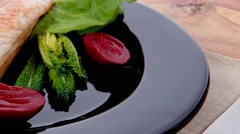 Turkey meat steak fillet on black with cutlery on wood Stock Footage
