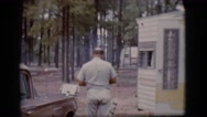 1968: bald headed old man is closing the door of a cabin in the woods Stock Footage