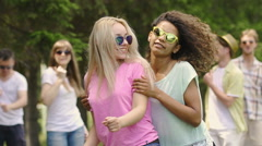 Cheerful girls band dancing in front of camera at talent show, flirting, smiling Stock Footage