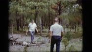1968: two men collecting firewood in the woods by a road COTTONWOOD, ARIZONA Stock Footage