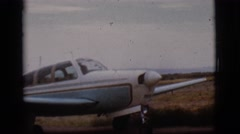 1968: dad goes on flight over the mountains and brings fun sized kids  Stock Footage
