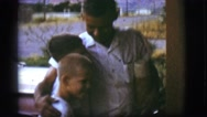 1968: father is welcomed by the handsome sons to the house COTTONWOOD, ARIZONA Stock Footage