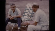 1968: two persons are sitting on the chairs and talking something COTTONWOOD, Stock Footage