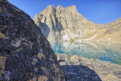 A glacial lake sits at the base of Radalet Peak in the Yukon Coast Mountains. Stock Photos