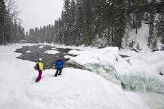 A couple snowshoes towards Mushbowl Falls in Wells Gray Provincial Park, Stock Photos